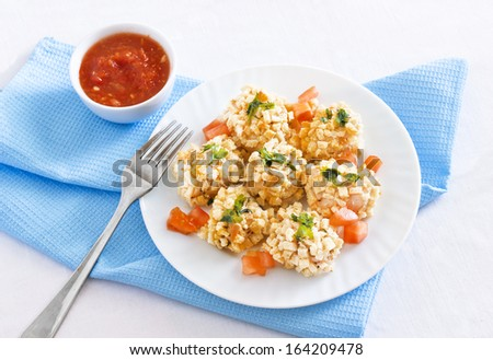 Chicken breast in breadcrumbs (breading) with garlic sauce on the table - stock photo