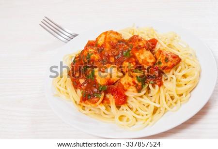 chicken breast in tomato sauce with spaghetti - stock photo
