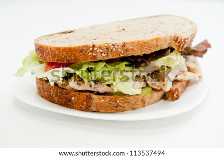 chicken breast, mayo, lettuce and heirloom tomato on delicious seed bread, a healthy organic alternative
