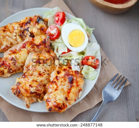 Chicken breast with a cheese crust - stock photo