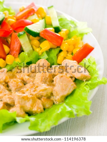 chicken breast with cheese sauce and fresh vegetable salad