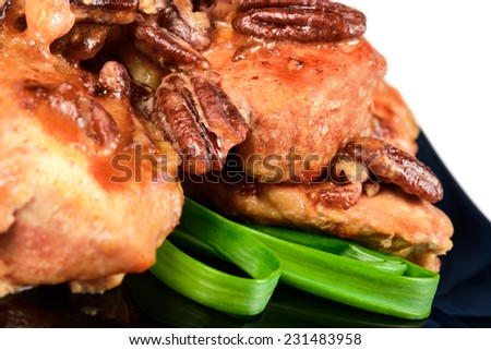 Chicken breast with nuts. Isolated on white background. - stock photo
