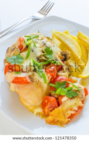 Chicken breasts baked with tomatoes and mushrooms - stock photo
