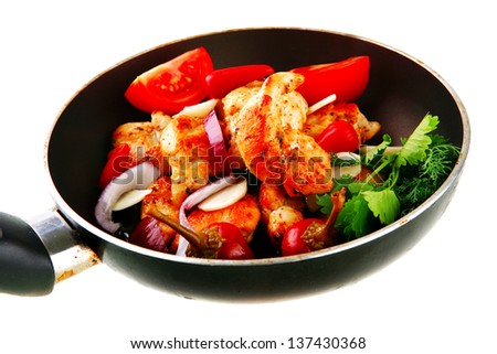 chicken briskaet fried on pan with vegetables
