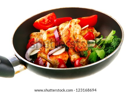 chicken brisket fried on pan with vegetables - stock photo