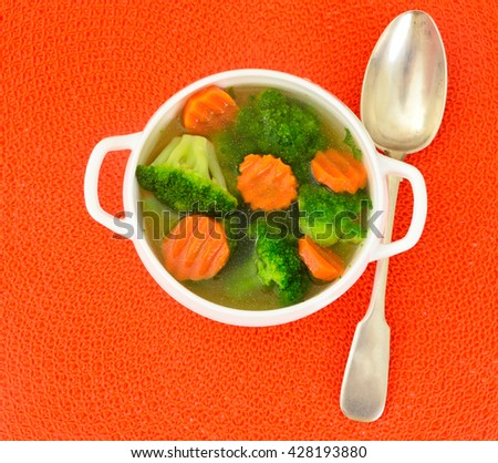 Chicken Broth with Broccoli and Carrots Studio Photo
