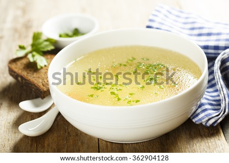 Chicken broth with herbs - stock photo