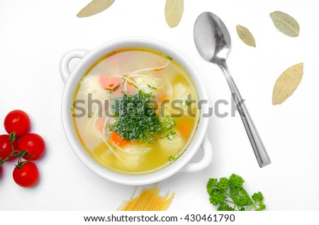 Chicken broth with meatballs  - stock photo