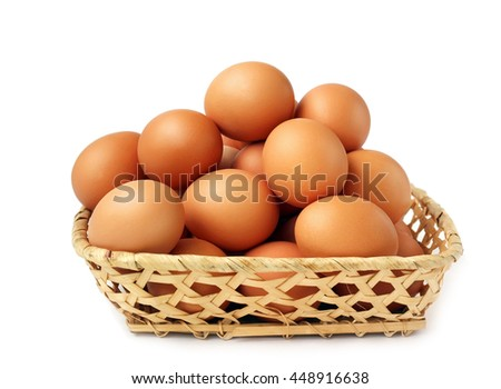 Chicken brown eggs in a wicker basket on a white background (not isolate).