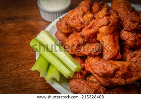 Chicken Buffalo Wings with Celery Sticks - stock photo
