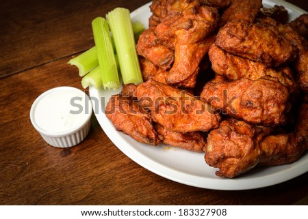 Chicken Buffalo Wings with Celery Sticks and Blue Cheese Dressing - stock photo