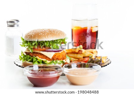 Chicken burger and glass of cola with ice