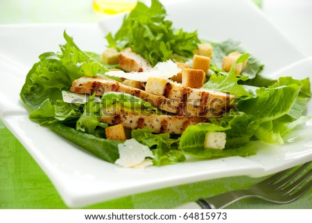 Chicken Caesar salad  on the white plate - stock photo