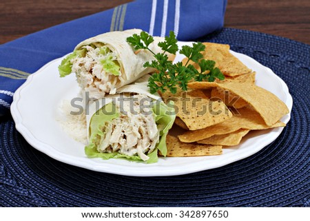 Chicken caesar wraps with tortilla chips.