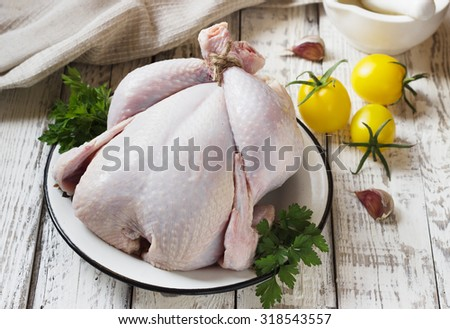 chicken carcass is not cooked on a white wooden background
