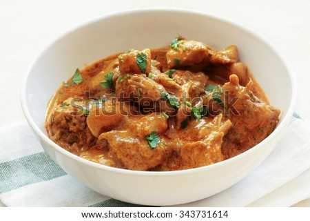 Chicken curry in a bowl / Malaysian chicken curry, selective focus - stock photo