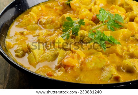 Chicken curry in  bowl on  wooden table. Selective focus - stock photo