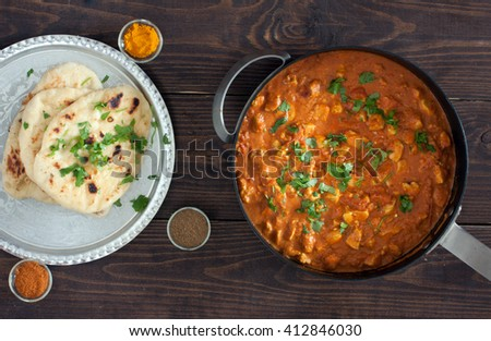 chicken curry, plain naan bread - stock photo