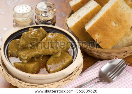 Chicken Curry Served with Focaccia Bread