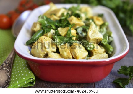 Chicken curry with asparagus bean on a rustic wooden background. - stock photo