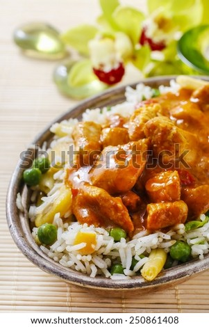 Chicken curry with basmati rice and green peas, dish popular in India. - stock photo