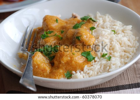 Chicken curry with boiled rice in a bowl