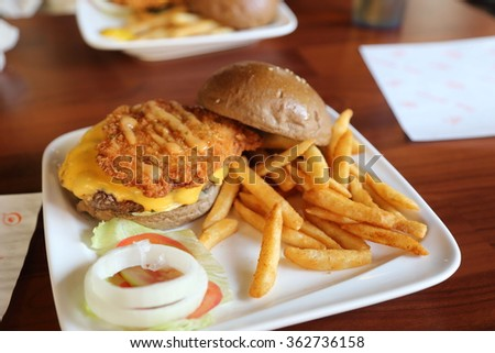 chicken cutlets Hamburger with Cheese and French fries