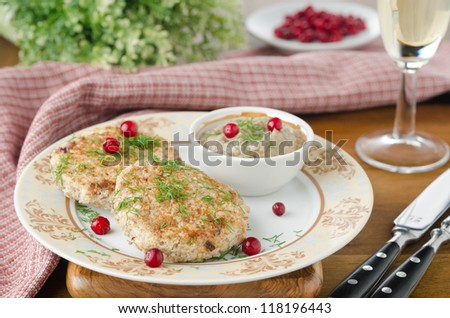Chicken cutlets with cowberry and mushroom sauce