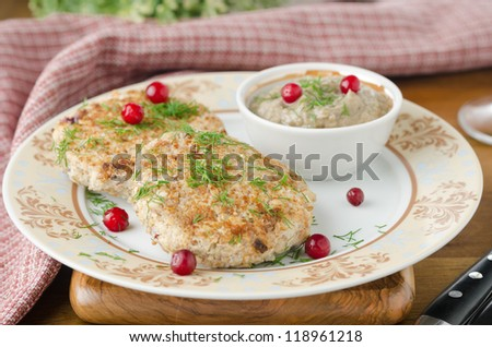 Chicken cutlets with cowberry and mushroom sauce selective focus