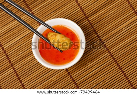 Chicken deep fried in batter with a Sweet and Sour dipping sauce