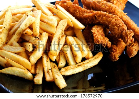 chicken drumstick on french fried  in black bowl  - stock photo