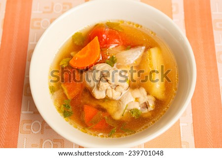chicken drumstick soup with vegetables, thai style.