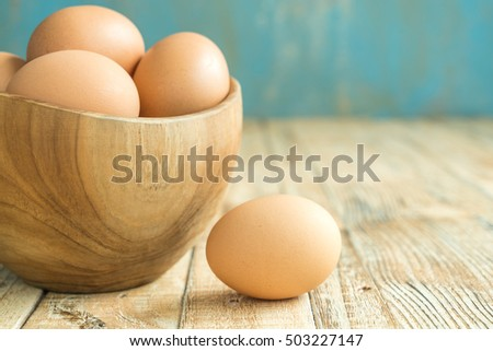 Chicken Egg on the wood background