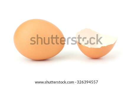 Chicken eggs and egg shell closeup isolated on white background