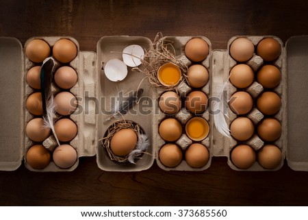 chicken eggs flat lay still life rustic with food stylish raw ingredient poultry healthy cholesterol protein vitamin natural rustic low key - stock photo