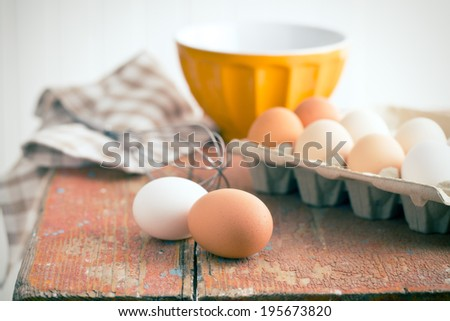 chicken eggs on old table - stock photo