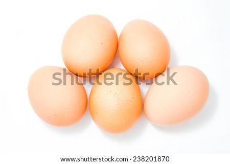 Chicken Eggs on white background - stock photo