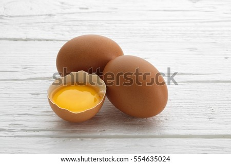Chicken eggs on white wooden table