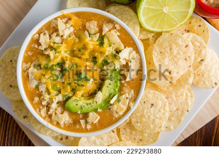Chicken Enchilada Soup with Avocado and Tortilla Chips - stock photo