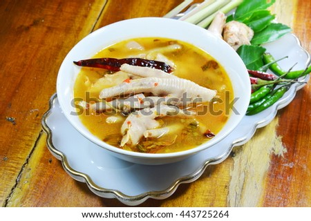chicken feet with tamarind leaf spicy soup and mixed ingredient herb - stock photo