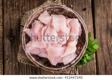 Chicken Fillet (chopped) on vintage wooden background (selective focus) - stock photo