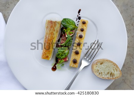 Chicken fillet, figs and polenta on a plate - stock photo