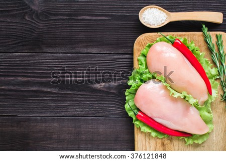Chicken fillet on a cutting board. Top view. - stock photo