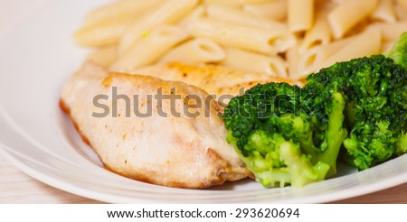 chicken fillet with penne pasta and broccoli - stock photo
