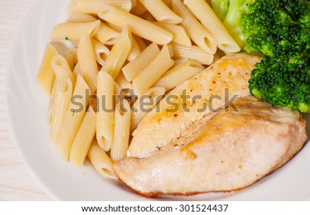 chicken fillet with penne pasta and broccoli
