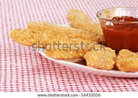 chicken fingers focus on bowl - stock photo