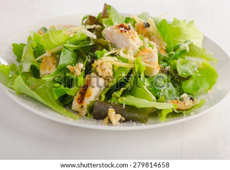 Chicken fresh salad on a white plate. Selective focus - stock photo