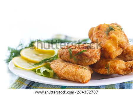 chicken fried in batter with dill on a white background
