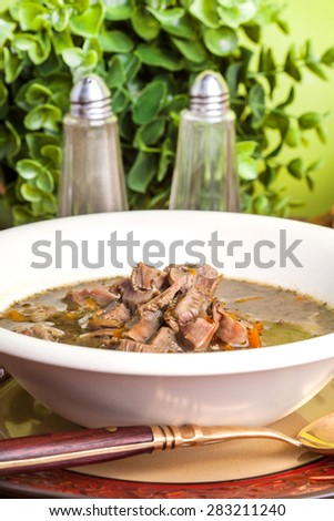 Chicken gizzards stewed with carrot in sauce. - stock photo