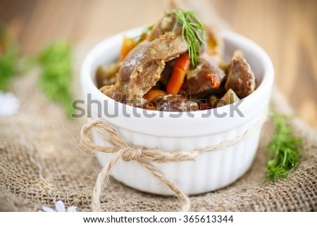 chicken gizzards stewed with vegetables - stock photo
